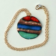 "Gazing Out Across the Lake Landscape © Larry Knox Round Pendant (4cm) with 18"" Bronze Chain $80"